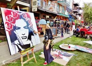MC Groua, artiste-peintre en production publique lors de Limoilou en musique ce dimanche 21 juin.